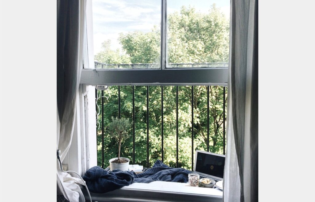 Bedroom with burglar bars laptop by window